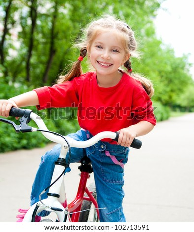 little girl with her bicycle