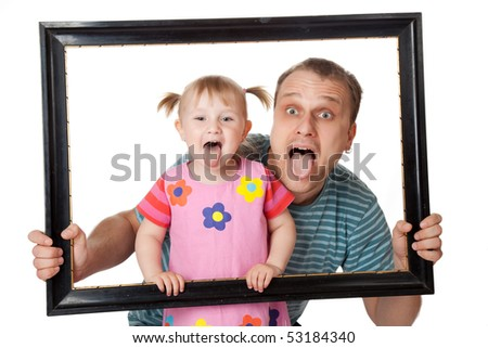 little girl with her dad in wooden frame - stock photo