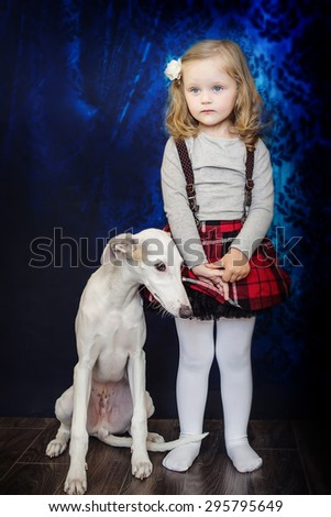 little girl with her dog - stock photo