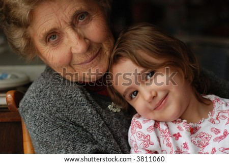 Little girl with her Great-grandmother - stock photo