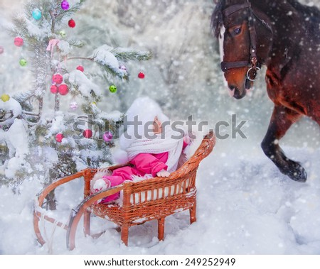 Little girl with horse at christmas eve. - stock photo
