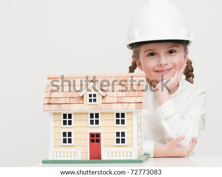 Little girl with house model (self made house)
