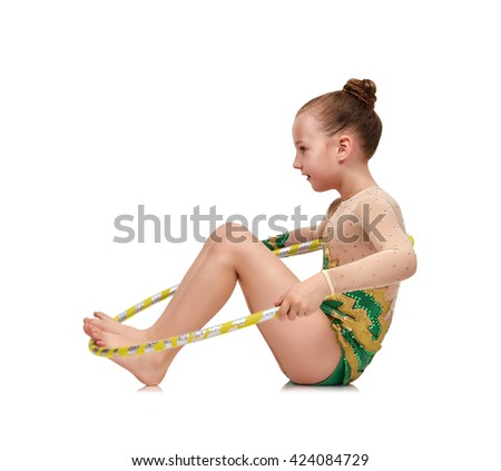Little girl with hula hoop doing gymnastics on white background - stock photo