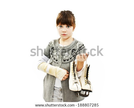 Little girl with ice skating  and broken arm. Isolated on white background - stock photo