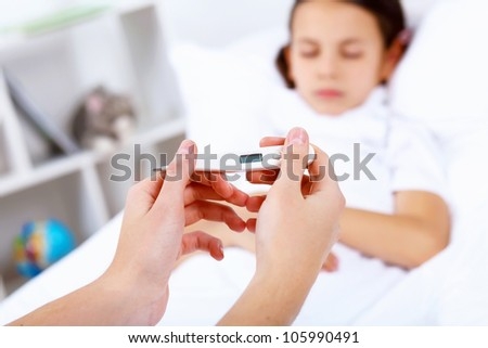 Little girl with illness at bed at home