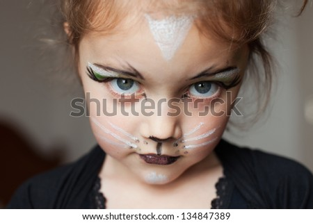 little girl with kitty cat make up - stock photo