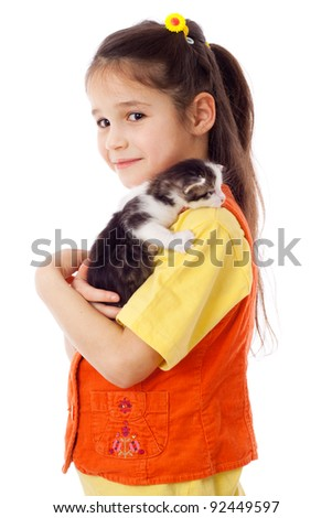 Little girl with kitty on shoulder, isolated on white