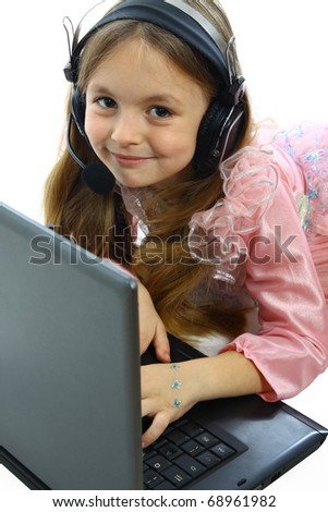 little girl with laptop and headphones isolated on white - stock photo