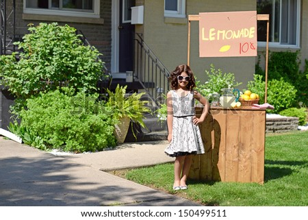little girl with lemonade stand - stock photo