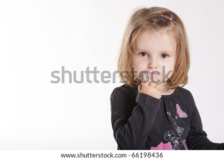 little girl with lipstick