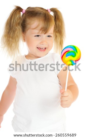 Little girl with lollipop isolated - stock photo