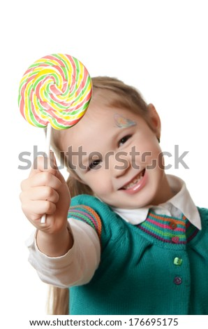 Little girl with lollipop isolated on white