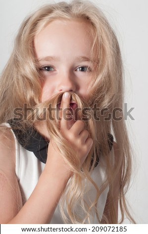 Little girl with long hair fooling around - stock photo