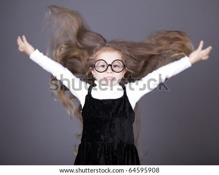 Little girl with long hair. Studio shot. - stock photo