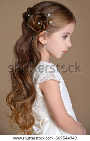 Little girl with long healthy brunette hair with creative braid hairdo on Health care theme - stock photo