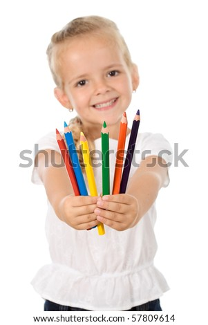 Little girl with lots of pencils smiling happily - isolated - stock photo