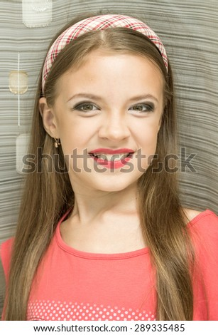 little girl with makeup portrait, smiling at the camera
