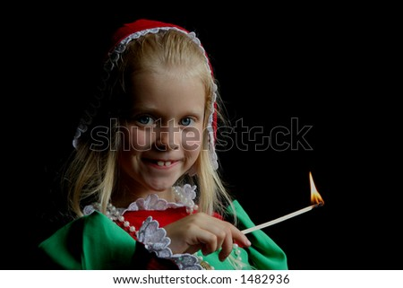 Little girl with match - stock photo