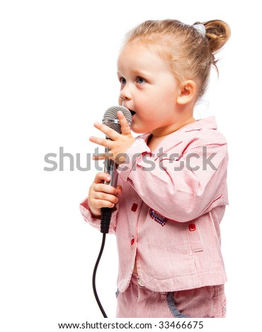 Little girl with microphone. Isolated on white background - stock photo