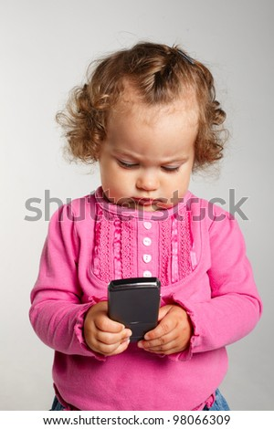 little girl with mobile phone - stock photo