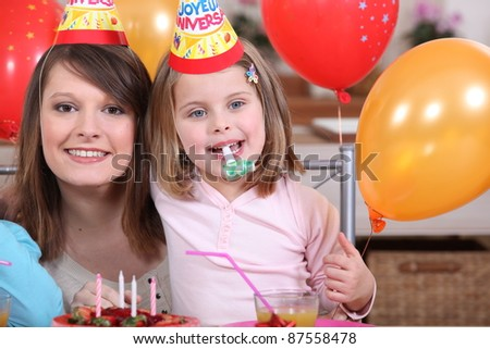 Little girl with mother at party