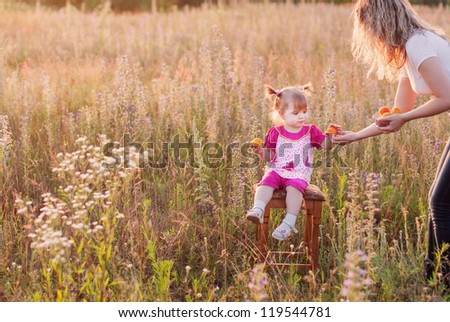 little girl with mother outdoor - stock photo