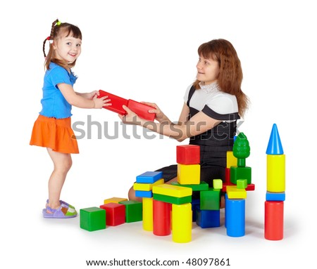 Little girl with mother playing with colored blocks on white background
