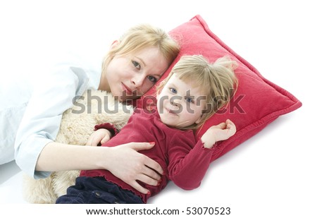 little girl with mum lying on red pillow