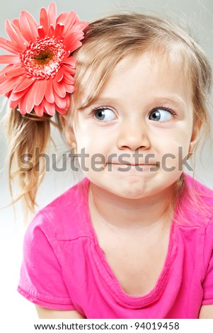 Little girl with  of gerbera flowers - stock photo