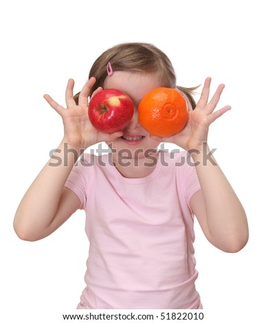 Little girl with orange and apple isolated on white background - stock photo