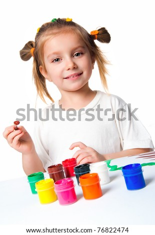 little girl with paint over white background - stock photo