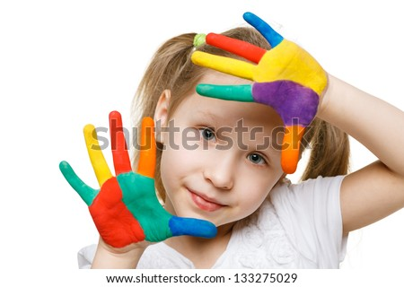 Little girl with painted fingers - stock photo