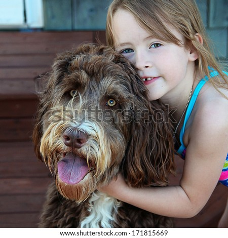 Little Girl with pet dog closeup - stock photo