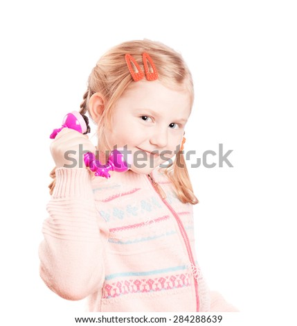 little girl with phone - stock photo