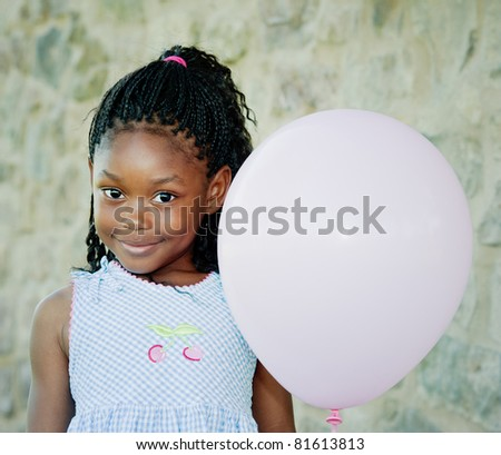 Little girl with pink balloon. She is about 5 years old. Room for text left and right. - stock photo