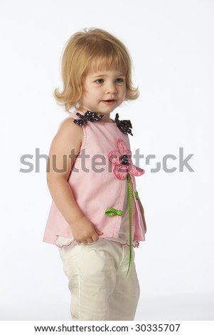 Little girl with pink flower dress - stock photo