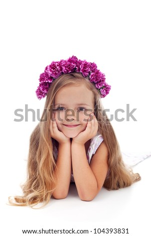 Little girl with pink violet floral wreath - portrait on white - stock photo
