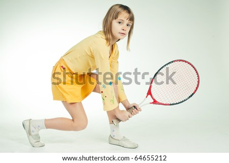 little girl with plays tennis - stock photo