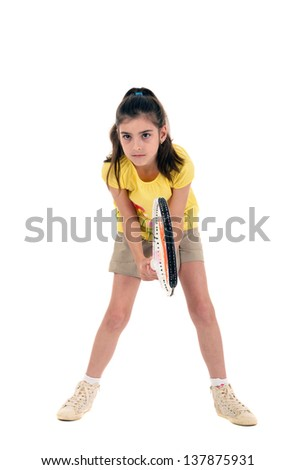 little girl with plays tennis on a white background - stock photo