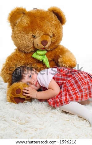little girl with plush - bear
