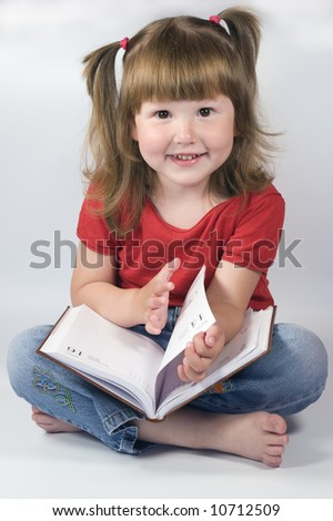Little Girl with ponytails is holding a day planner, studio