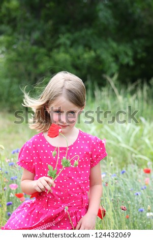 Little girl with poppy flowers - stock photo