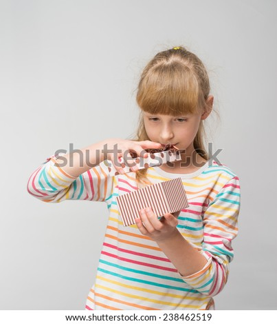Little girl with present - stock photo