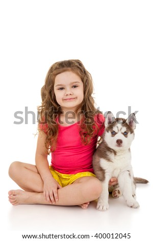 Little girl with puppy husky - stock photo