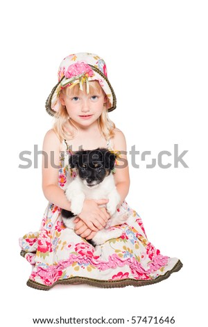 little girl with puppy isolated on white
