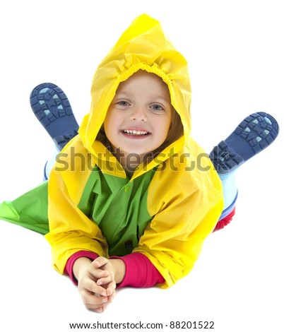 little girl with raincoat and gum boot
