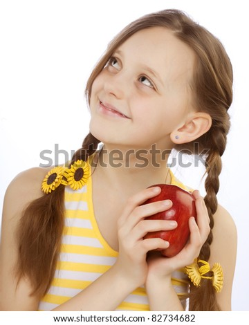 little girl with red apple - stock photo