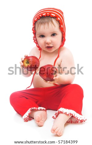little girl with red apples.she is sitting in the floor - stock photo