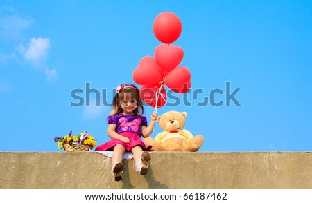 little girl with red ballons and teddy bear - stock photo