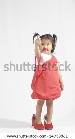 little girl with red lipstick - stock photo